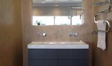 De Spaan Showroom / De Spaan Microcement betonlook naadloze badkamers Arnhem Nederland