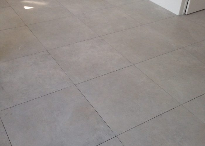 Nieuwbouw project tegels 75x75 betonlook verbouwingen arnhem gelderland showroom